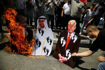 Palestinians burn cutouts depicting Donald Trump, Abu Dhabi Crown Prince Mohammed bin Zayed al-Nahyan and Benjamin Netanyahu, in Nablus, West Bank, August 14, 2020.