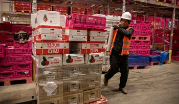 A worker prepares a grocery delivery from the Rami Levy supermarket chain, March 2020.