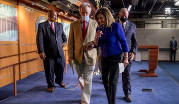 From left, Democratic Representatives Dwight Evan, Richard Neal, Nancy Pelosi, and Dan Kildee leave a news conference on Capitol Hill in Washington, July 24, 2020,