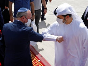 Israeli National Security Advisor Meir Ben-Shabbat, center left, elbow bumps with an Emirati official as he leaves Abu Dhabi, Arab Emirates, Sept. 1, 2020.