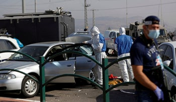 Members of Israeli security forces inspect the scene of an incident at Tapuah junction in the Israeli-occupied West Bank, September 2, 2020.