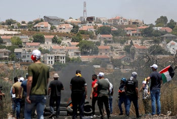 Palestinian demonstrators gather in front of the Israeli settlement of Kedumim during a protest in Kafr Qaddum near Nablus, on July 3, 2020.