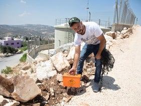 Waseem Shtaiwi with one of the explosive devices foundin Kafr Qaddum near Nablus, August 2020.