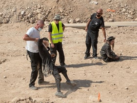 Security guard evacuate protesters from an archaeological site in Motza, Jerusalem, August 2020.
