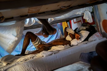 Hady Baye, 31, rests in a bunk bed at the Modern Christian Mission Church in Fuerteventura, one of the Canary Islands, Spain, on Saturday, August 22, 2020.