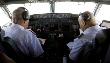 Pilots of El Al airliner carrying a delegation of Israeli and American officials are seen in the cockpit as the plane flies over Saudi Arabia en route to Abu Dhabi, August 31, 2020.