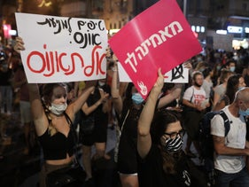 Israelis protest against sexual violence following the alleged gang rape of a 16-year-old in Eilat, Tel Aviv, August 2020.