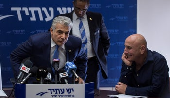 Yair Lapid and Ofer Shelah at a Yesh Atid party meeting, January 17, 2016.