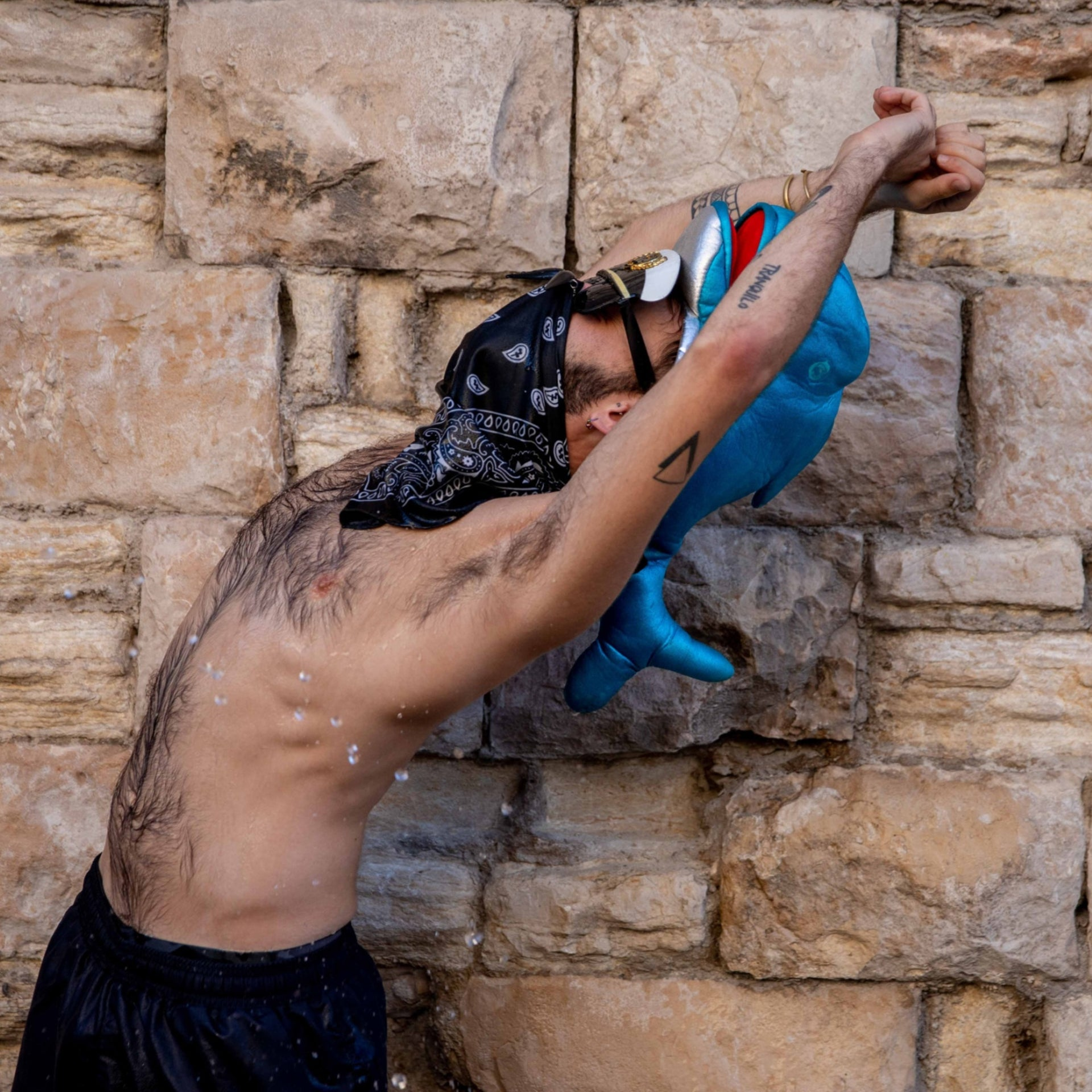 A protester wearing a dolphin shaped hat in Jerusalem, August 2020.