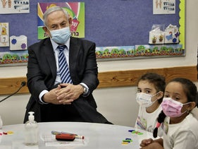 Netanyahu visiting a school amid reopening this week, Mevo Horon, in the occupied West Bank.
