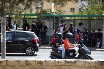 Students at a bus stop in Nazareth, September 3, 2020.