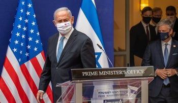 Netanyahu enters a joint press conference with Jared Kushner in Jerusalem, August 30, 2020.