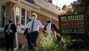 Democratic presidential candidate former Vice President Joe Biden reacts to the cheering people gathered in Wauwatosa Wis., Thursday, Sept. 3, 2020, as he leaves a backyard meeting with community members about education