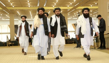 Afghanistan's Taliban delegation arrive for the agreement signing between Taliban and U.S. officials in Doha, Qatar, February 29, 2020