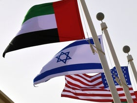 The Emirati, Israeli and US flags at the Abu Dhabi airport, August 31, 2020.