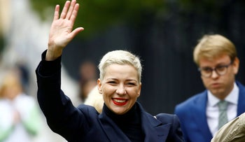 Belarusian opposition politician Maria Kolesnikova waves as she arrives for questioning at the Investigative Committee in Minsk, Belarus August 27, 2020.