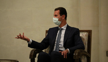 Syria's President Bashar al-Assad wearing a protective face mask attends a meeting with Russia's Deputy Prime Minister Yuri Borisov and Foreign Minister Sergei Lavrov in Damascus, Syria September 7, 2020.