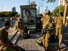 File photo: Israeli soldiers wait at a bus station in Tel Aviv, September 4, 2016.