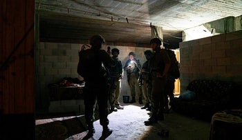 Israeli soldiers inspect the house of the Palestinian attacker, August 2020.