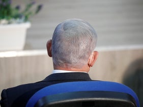 Netanyahu is seen from behind at a press conference on the coronavirus at Home Front Command, September 7, 2020