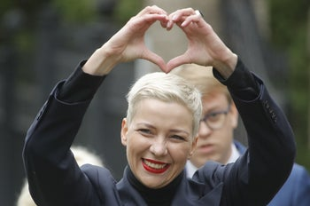 Maria Kolesnikova, one of Belarus' opposition leaders, gesturing on the way to the Belarusian Investigative Committee in Minsk, August 27, 2020.