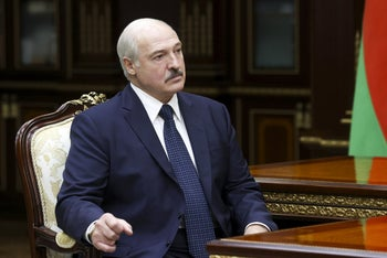 Belarusian President Alexander Lukashenko listening to the head of the Investigative Committee during a meeting in Minsk, September 7, 2020.