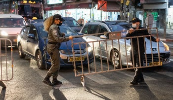 Police officers enforcing the nighttime curfew imposed on the predominantly ultra-Orthodox city of Bnei Brak, September 8, 2020.