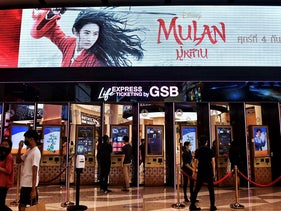 People buy tickets for Disney's Mulan film at a cinema inside a shopping mall in Bangkok on September 8, 2020