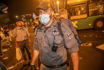 A police officer at the protest in Jerusalem, August 29, 2020.