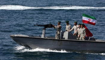 """File photo: Iranian soldiers take part in the """"National Persian Gulf day""""  in the Strait of Hormuz, April 30, 2019."""