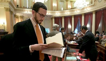 In this April 20, 2017 file photo, State Sen. Scott Wiener, D-San Francisco works at the Capitol in Sacramento, Calif