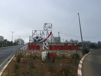 A sign welcoming drivers at the entrance to Ramallah in the West Bank, September 2020.