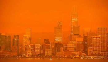 The San Francisco skyline is obscured in orange smoke and haze as their seen from Treasure Island in San Francisco, California on September 9, 2020