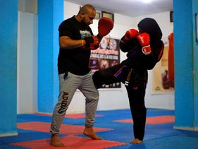 Martial arts trainer Seham Amer practices self-defense moves with another trainer at a training center in Sanaa, Yemen September 8, 2020.