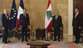 French President Emmanuel Macron, second left, and Lebanese President Michel Aoun, second right, meet at Beirut–Rafic Hariri International Airport, in Lebanon, August 6, 2020.