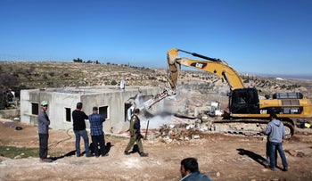 The IDF demolishes illegal Palestinian homes in village of Yatta, near Hebron, West Bank, July 9, 2015