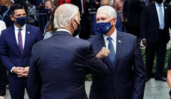 Joe Biden, left, greets Vice President Mike Pence, right, at the National September 11 Memorial and Museum, New York, September 11, 2020.