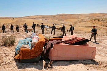 Members of the Border Police following the demolition of Palestinian homes south of Yatta in the West Bank, June 2020.