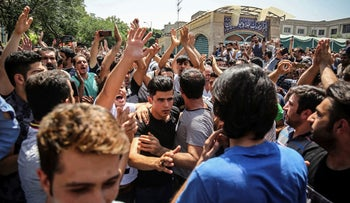 A group of protesters chant slogans at the main gate of the Old Grand Bazaar, in Tehran, Iran, June 25, 2018.