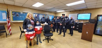 Amber Adler and her sons bringing meals to the 61st Precinct in southern Brooklyn during the coronavirus crisis.