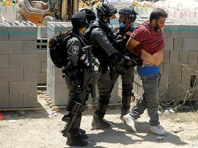 Israeli border police members detain a Palestinian demonstrator during a protest against Jewish settlements, in Haris near Salfit in the Israeli-occupied West Bank August 21, 2020.