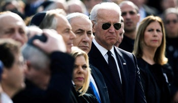 Joe Biden stands next to Benjamin Netanyahu and his wife Sara at a memorial ceremony for former Israeli prime minister Ariel Sharon at the Knesset in Jerusalem, 2014.