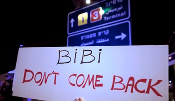 An Israeli protester at a demonstration against Israeli Prime Minister Benjamin Netanyahu before his flight to the U.S. to sign an accord with U.A.E, near Tel Aviv, Sept. 13, 2020
