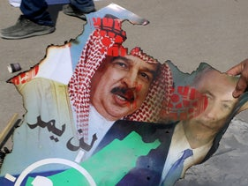 Palestinians burn a poster of Bahrain's King Hamad Al Khalifa and Benjamin Netanyahu at a protest against the UAE and Bahrain's normalization deal with Israel, Gaza City, September 15, 2020.