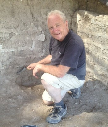 Archaeology student Jacob Schreibman uncovering mudbrick walls at Tell Azekah