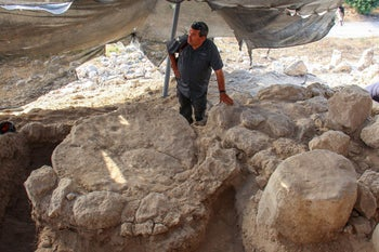 Archaeologist Oded Lipschits standing in Bronze Age temple at Azekah