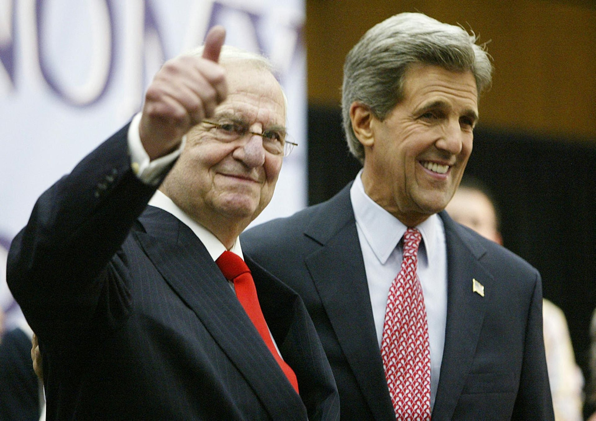 Chrysler CEO Lee Iacocca, left, with then-Democratic presidential nominee John Kerry in 2004. Nessa Rapoport worked with Iacocca on his best-selling memoir in the mid-1980s.