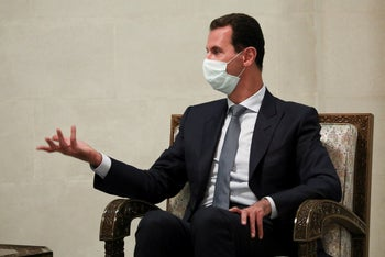 Syrian President BasharAssad gestures while speaking to Russian Foreign Minister Sergey Lavrov during their talks in Damascus, September 7, 2020.