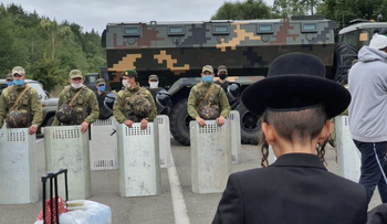 Jewish pilgrims, who plan to enter Ukraine from the territory of Belarus, gather in front of Ukrainian service members near Novi Yarylovychi crossing point in Chernihiv Region, Ukraine, September 15, 2020.