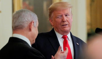 U.S. President Donald Trump winks at Israel's PM Benjamin Netanyahu during a joint news conference in the East Room of the White House in Washington, D.C., January 28, 2020.